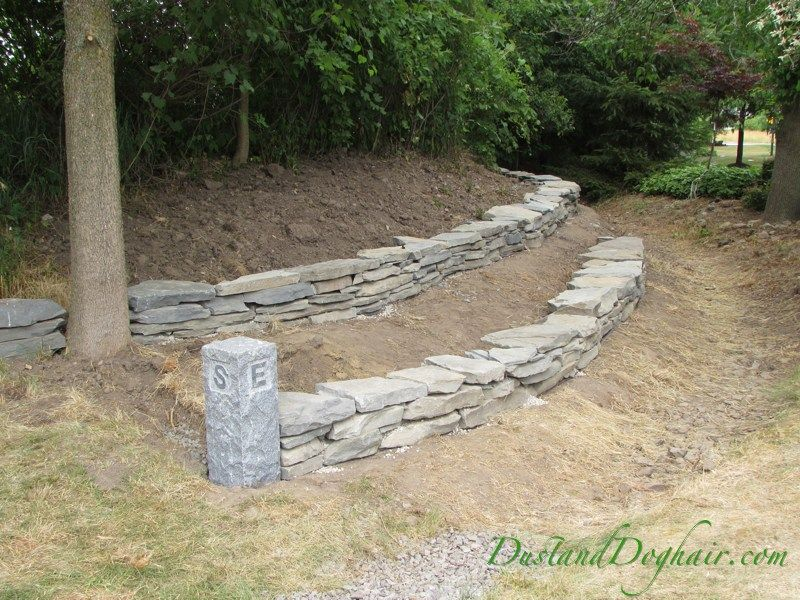 Diy stacked stone retaining wall part 2 dry stack for Soil yourself