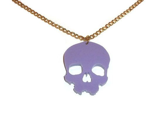 Laser cut lilac skull necklace * 18 inch gold plate chain * Laser cut acrylic pendant, about 1.5 inches tall * All my jewelry is lead and nickle free If you would like a different chain length or a bronze/gold/silver chain please leave a note at checkout. If you have shipping