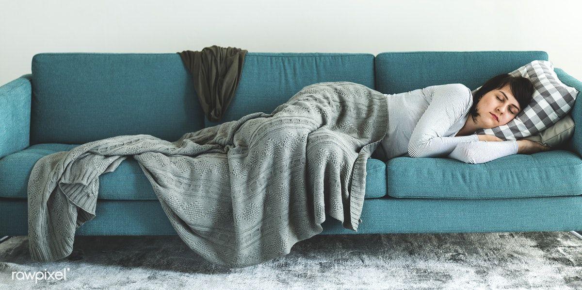 Woman sleeping on the sofa premium image by