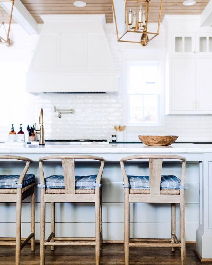 White Kitchen With Wood Ceilings. Chic, Modern, And
