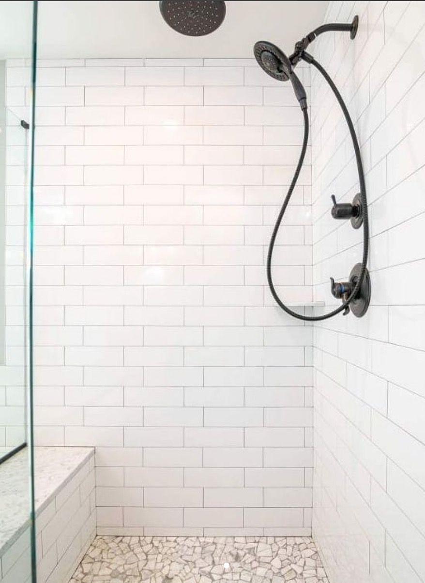 Photo of Modern farmhouse bathroom. White subway tile, oil rubbed bronze, master shower, …