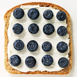 Healthy lunch: Whipped cream cheese and fresh blueberries on whole wheat toast.