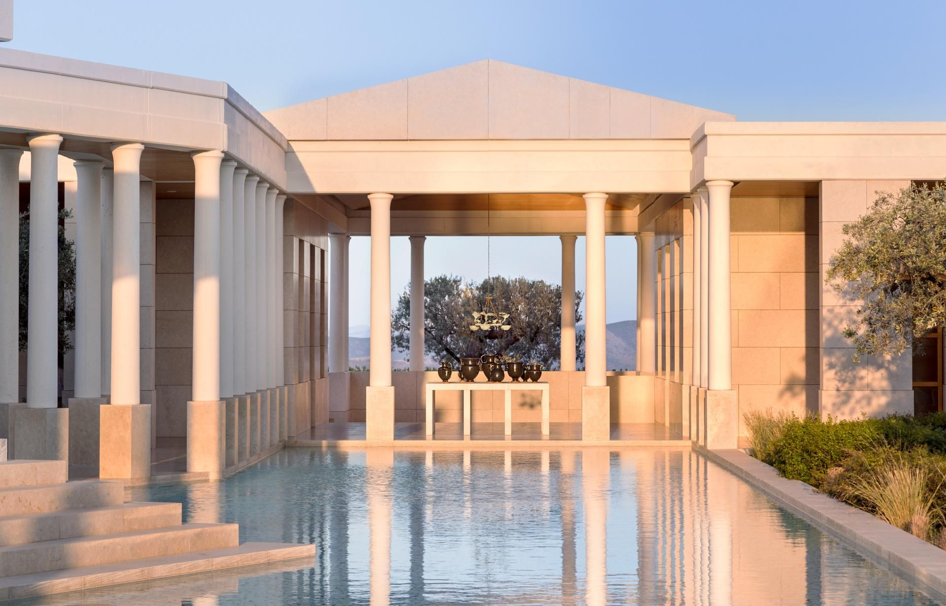 The Amanzoe comprises of a hilltop complex overlooking olive groves and with a backdrop of mountains seen across a cobalt-blue bay, 10 minutes by water taxi from the pretty yachting village of Porto Heli.   Truly feel like a VIP when you book with Travel with Terra and get these Exclusive Terra Perks -   ** Continental Breakfast for two daily in the Dining room or Room Service  ** $100USD Hotel credit, per room, per stay