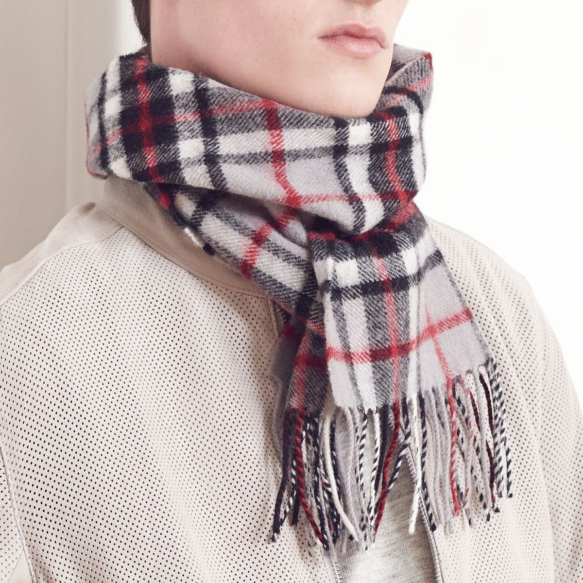 These scarves are made from pure 100% lambswool, they are lightweight, soft and cosy. Scarf Dimensions: 180cm x 25cm Including Fringing. They are made in our Selkirk Mill in Scottish Borders.