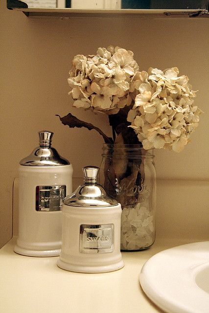 Love the flowers in the mason jar don 39 t forget the for Bathroom jar ideas