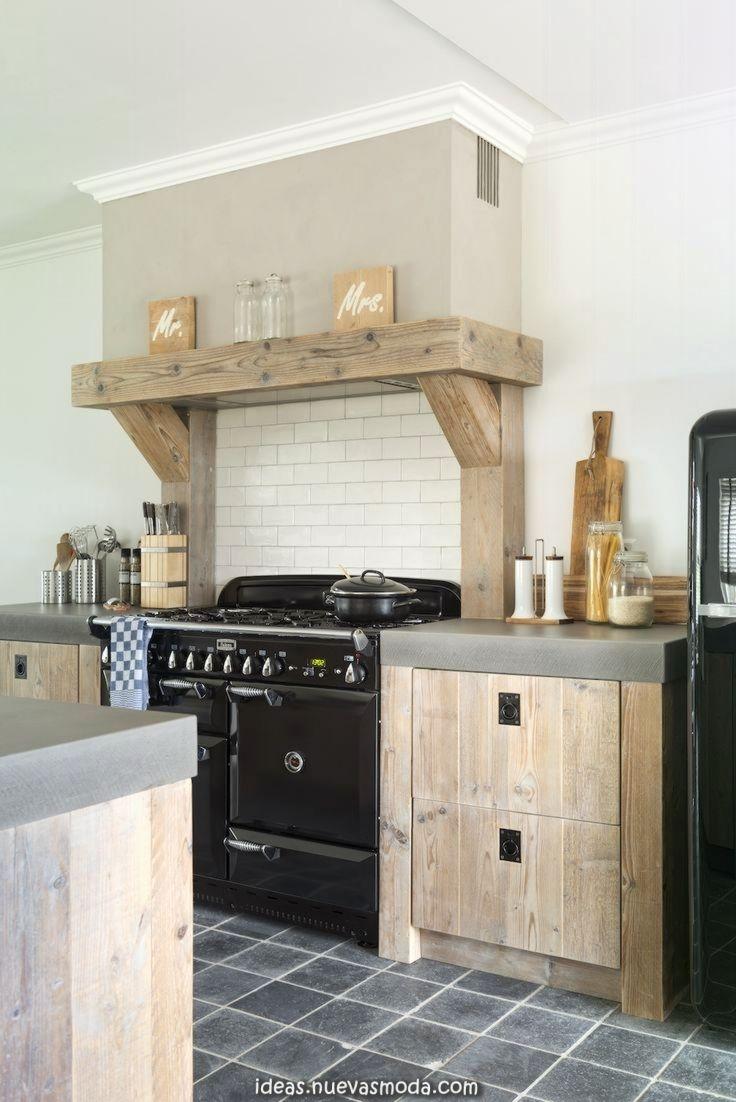 Cocina de estilo rústico con encimera de hormigón  Cuisines