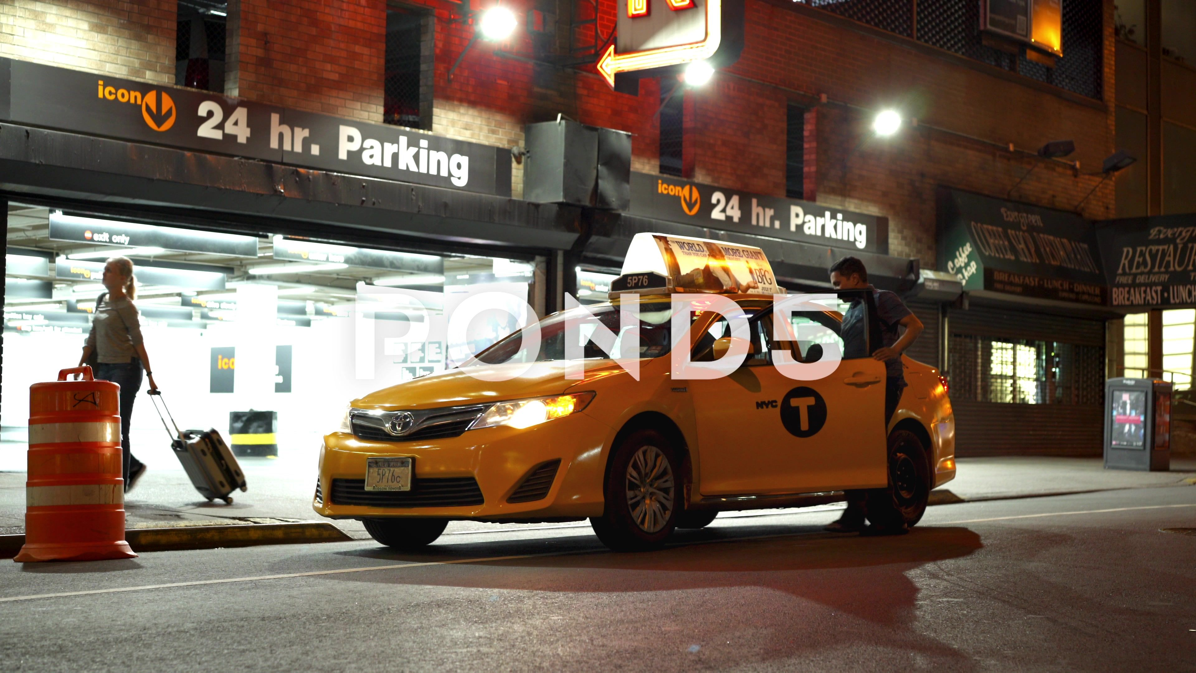 Taxi Stopped In Front Of Parking Garage In New York City 4k Stock Footage Front Parking Taxi Stopped Parking Garage New York City Taxi