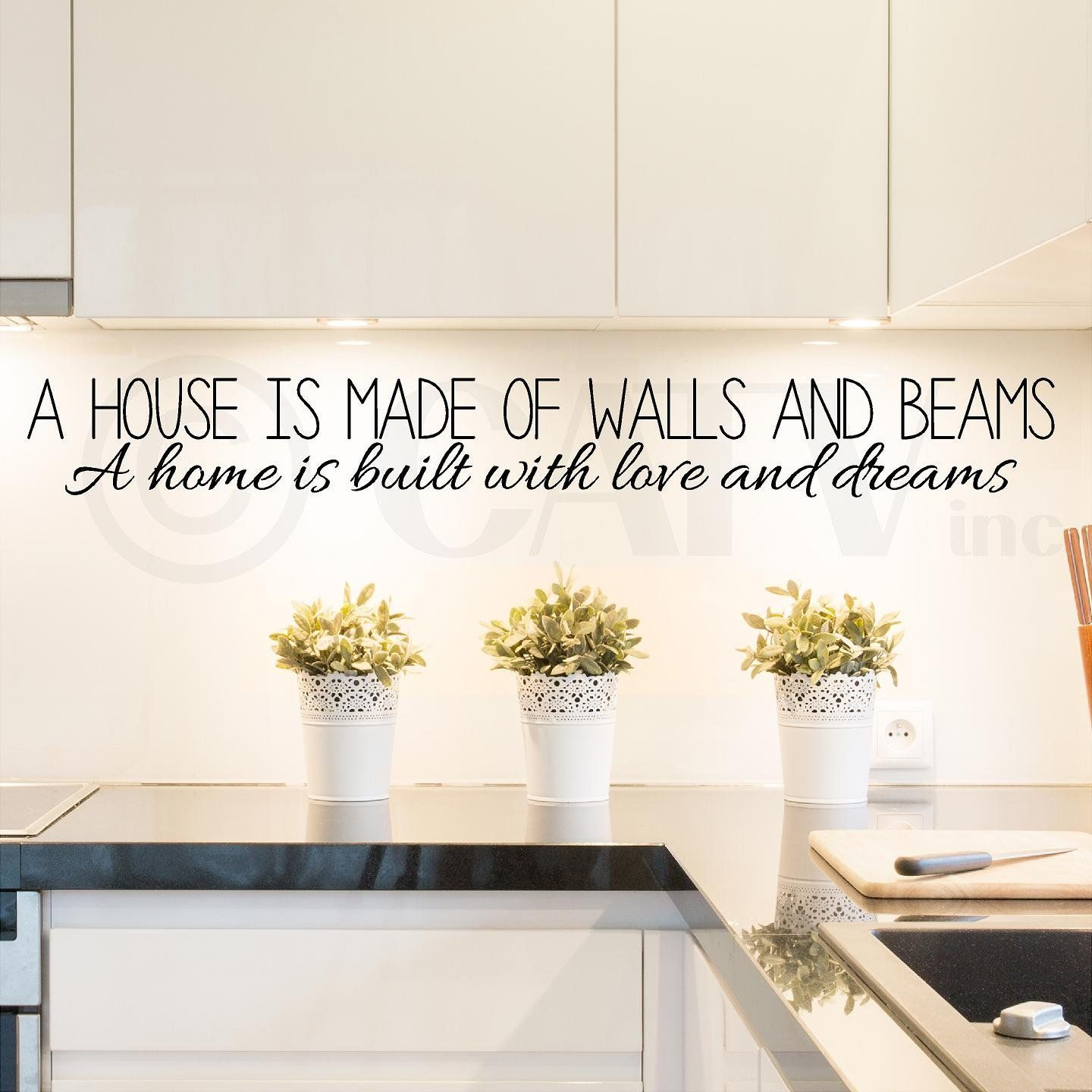 a house is made of walls and beams a home is built with love and