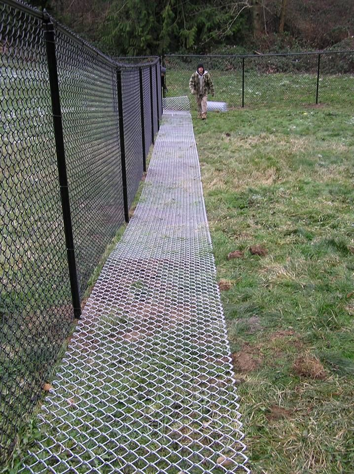 The Grass Will Grow Through The Ground Matting And Won T Even Be Visible After Awhile No Dog Is Going To Get Through That Dog Backyard Dog Fence Dog Yard