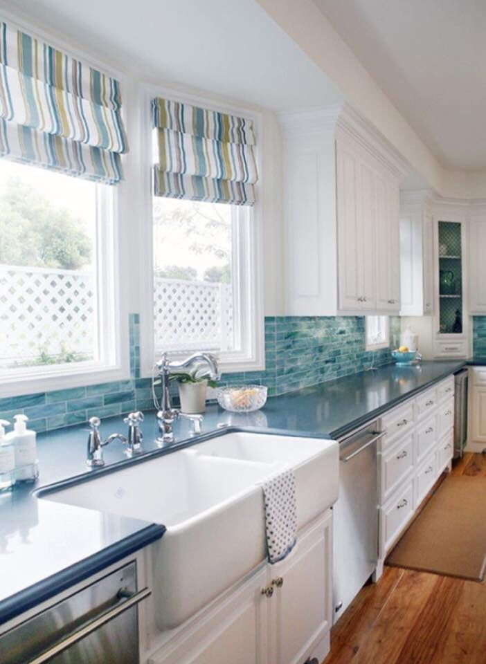 Watery Blue Green Tiles And Striped Roman Shades Lend A Coastal Feel To This White Kitchen