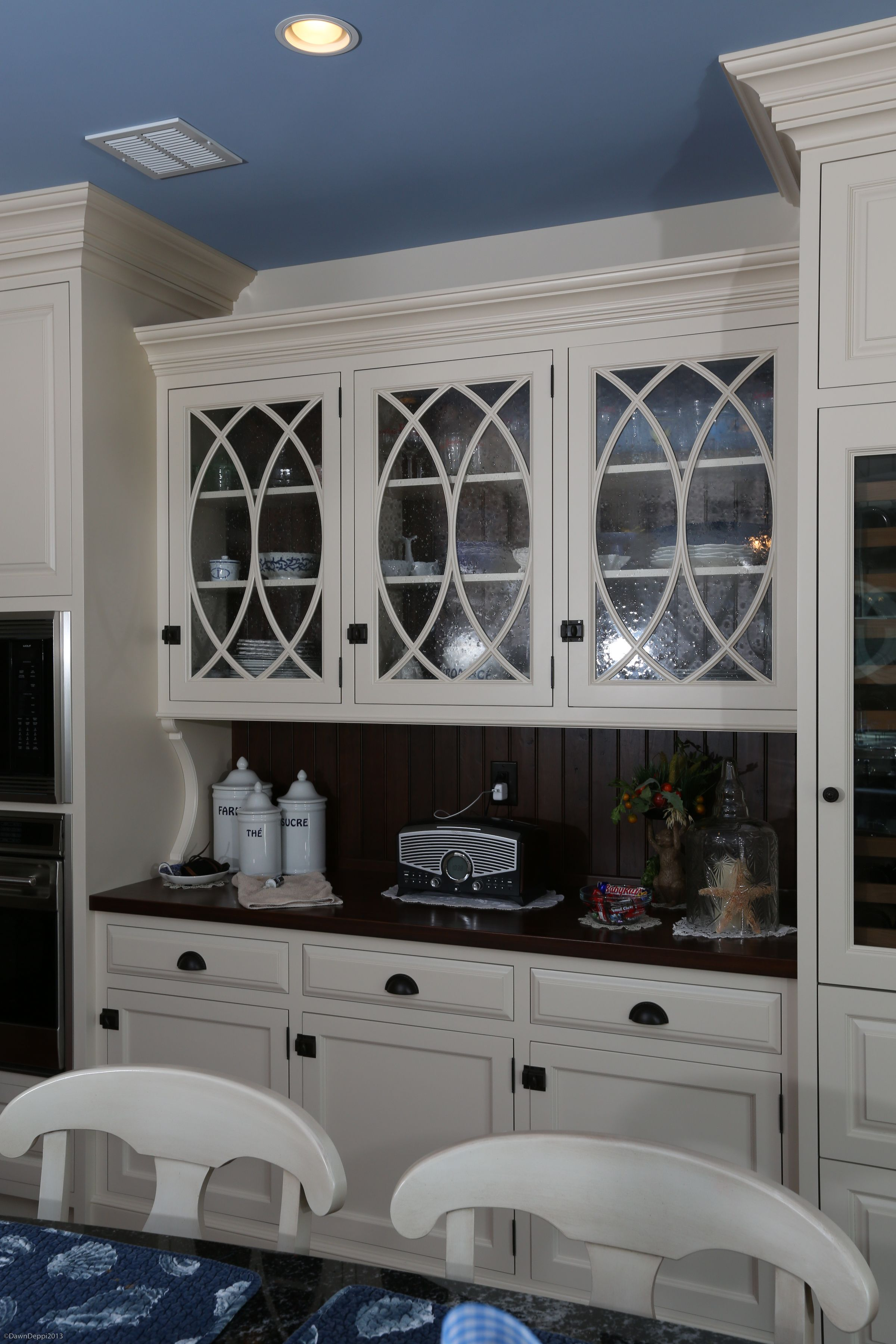 white painted hutch cabinetry with curved mullions and clear glass inserts contrasting b on kitchen cabinets glass inserts id=59409