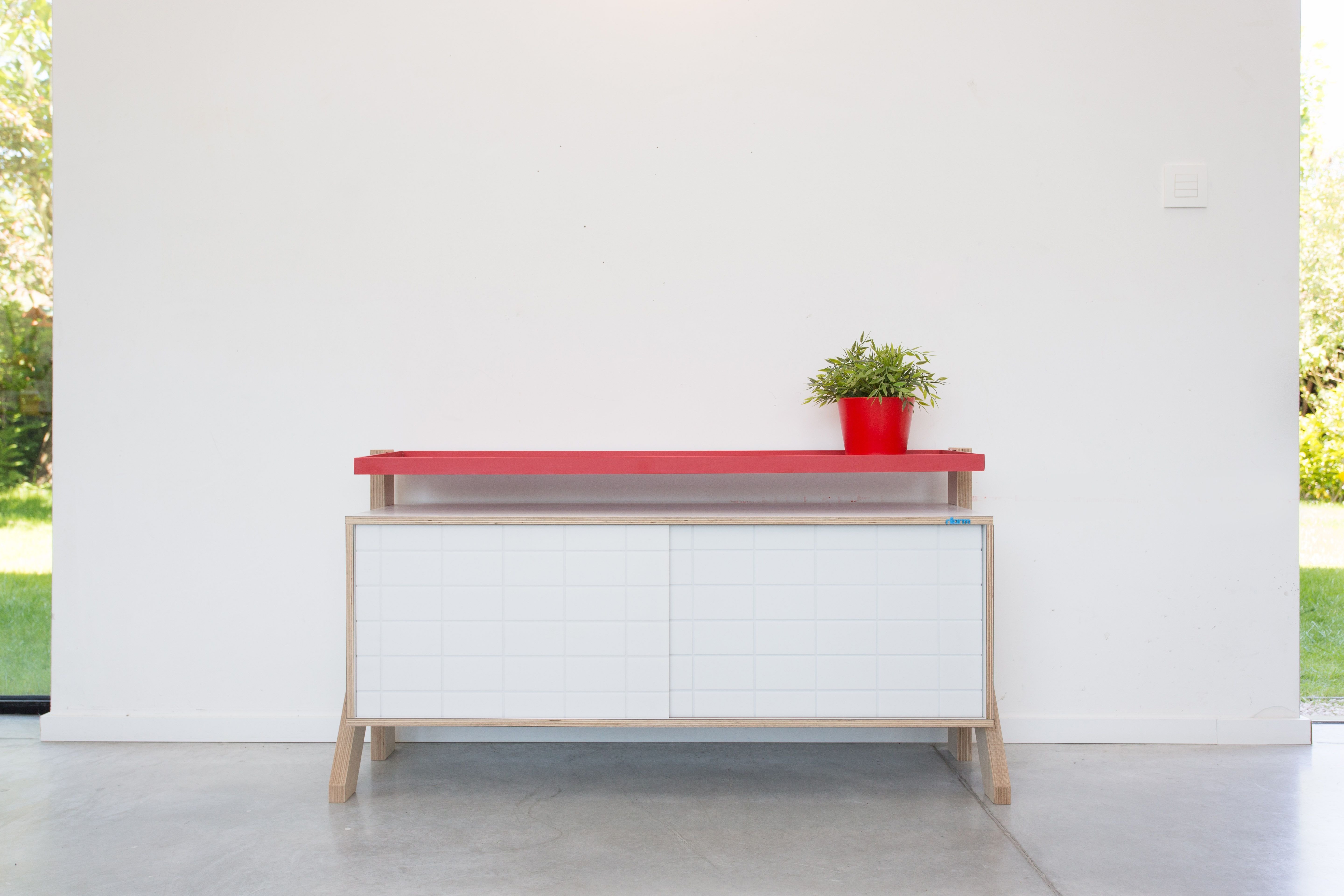 Frame 03 Small by Rform. Modern sideboard offered in eight different colors, with two intarchangeable doors and top shelf. Handmade in Birch plywood.
