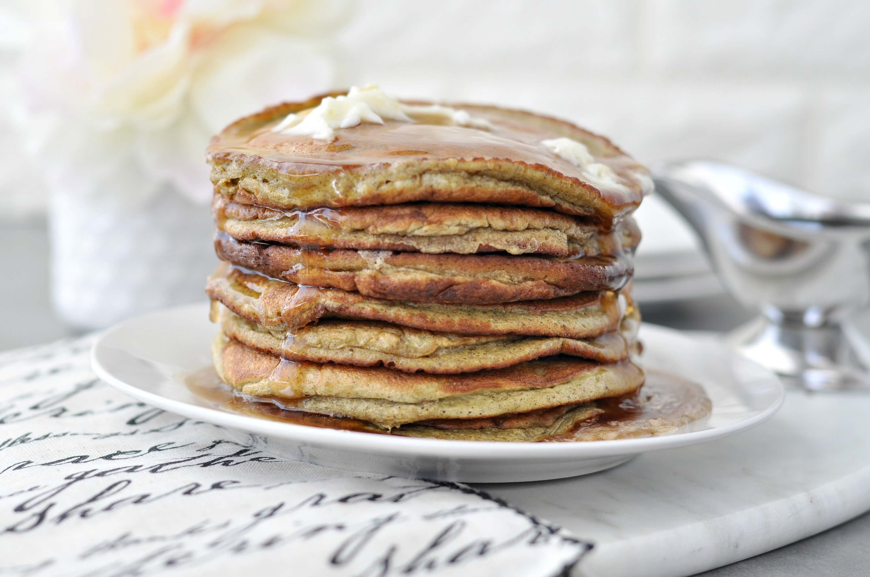 Low Carb Keto Banana Nut Protein Pancakes #proteinpowderpancakes Quick and easy low carb pancakes, made with protein powder. Blend these Low Carb Keto Banana Nut Protein Pancakes to get them nice and fluffy. #proteinpowderpancakes