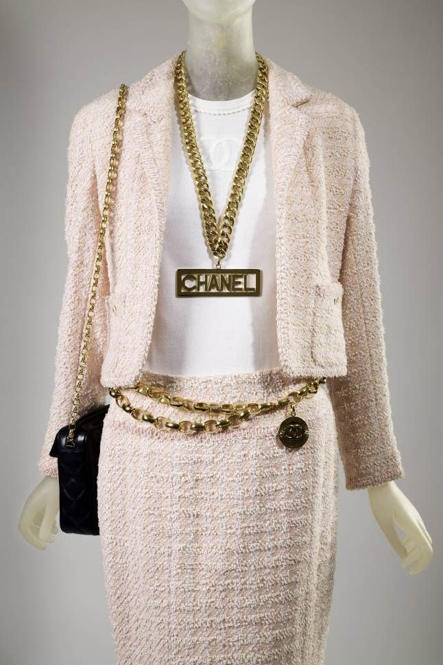 Spring 1994, France - Suit by Karl Lagerfeld for Chanel - Pink wool and synthetic blends, white cotton Fall 1991, France - Necklace by Karl Lagerfeld for Chanel - Gold plated metal