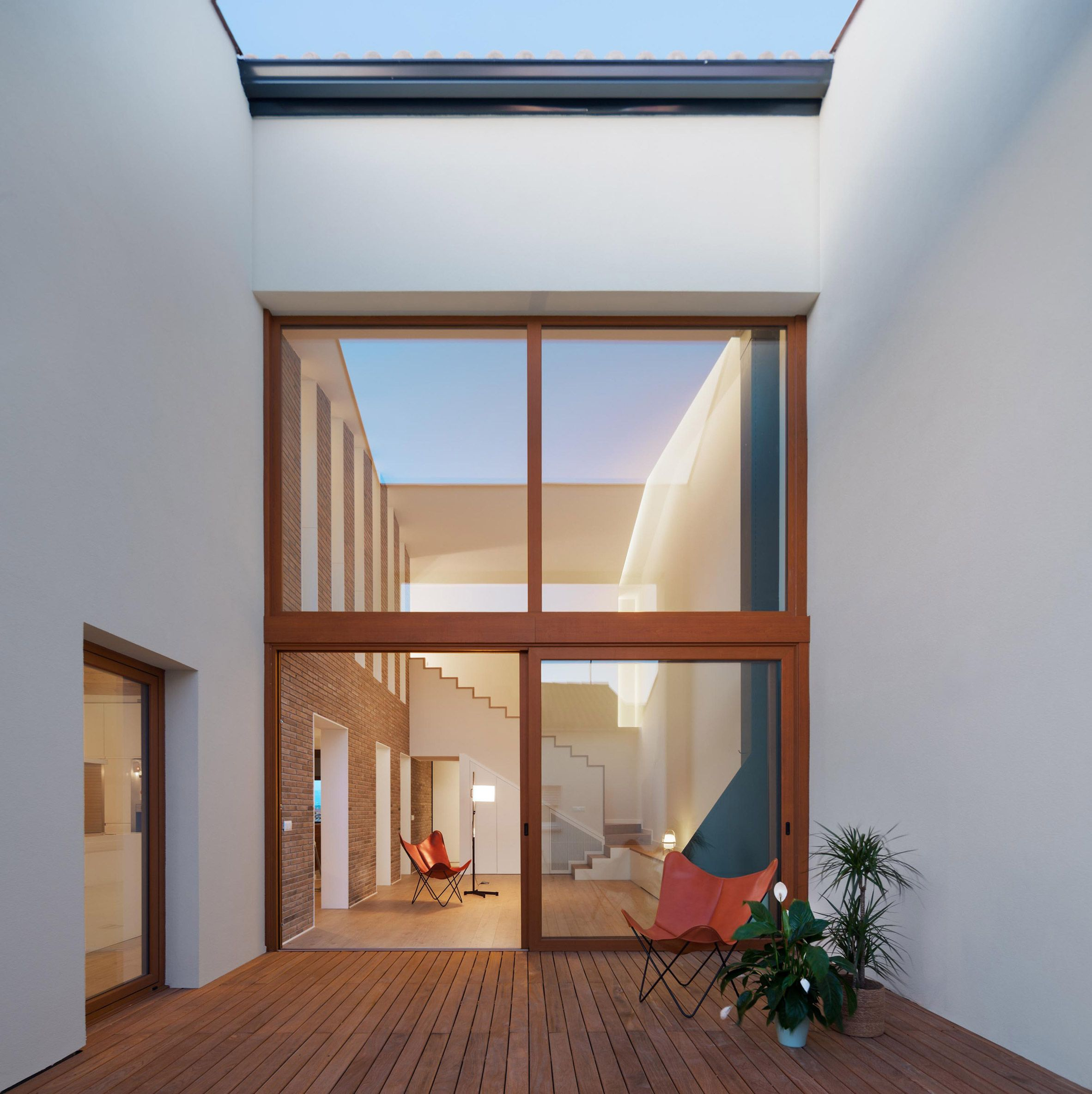 Family Home By Hiha Studio With Double Height Rooms And Rammed