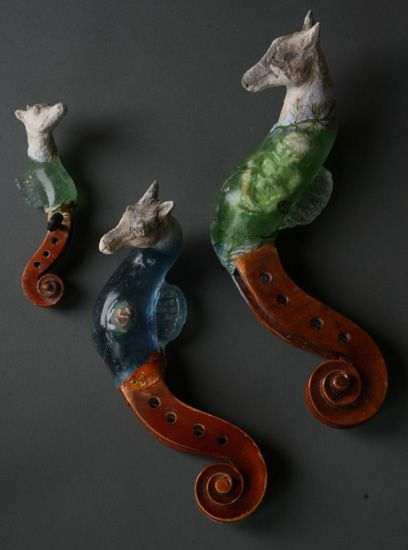 Seahorses - 2013  cast glass, raku clay, oil paints. scrolls from violin, viola, and cello. Christina Bothwell -http://christinabothwell.com/