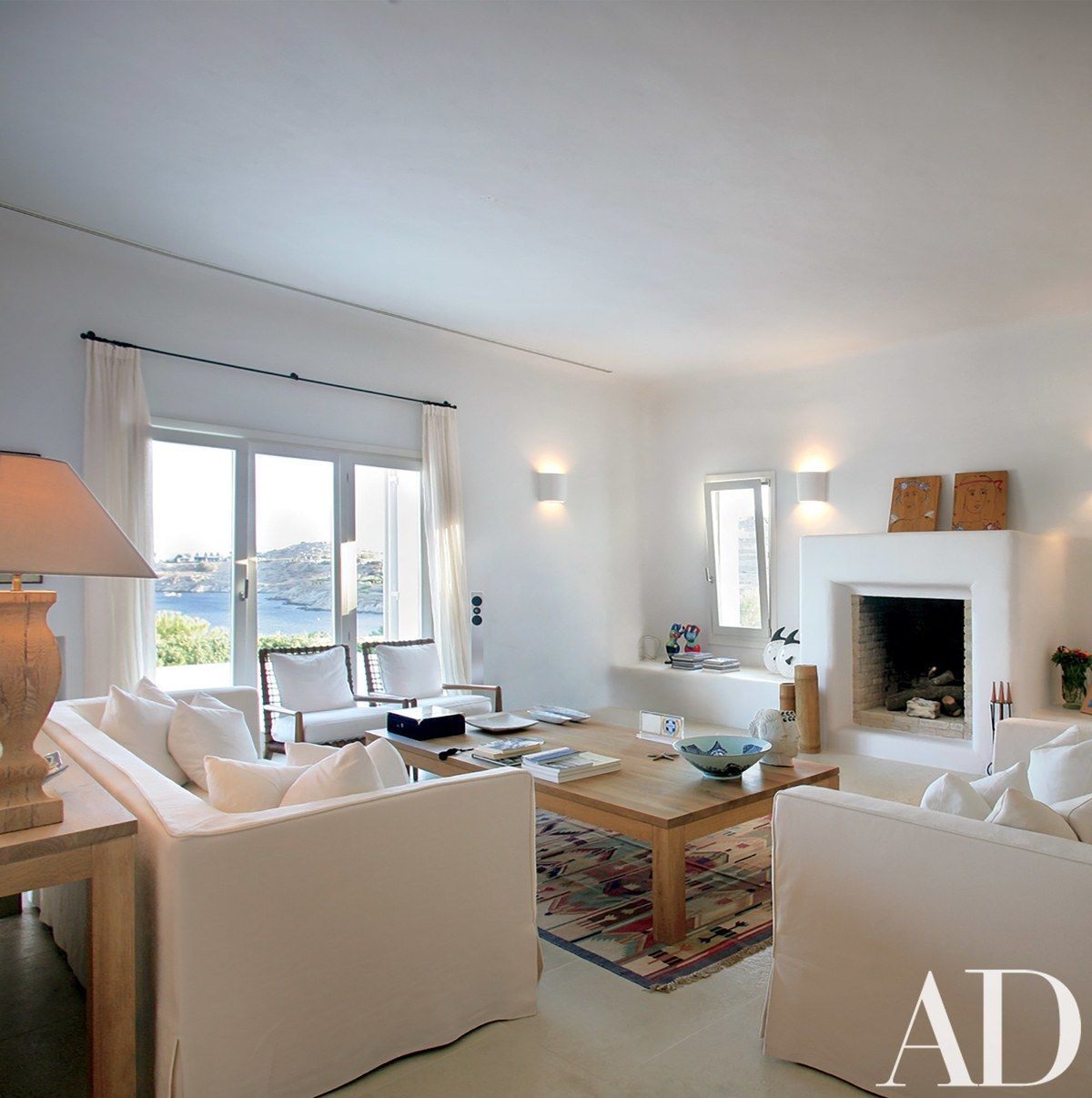The soothing palette of cream and white continues in the living area ...