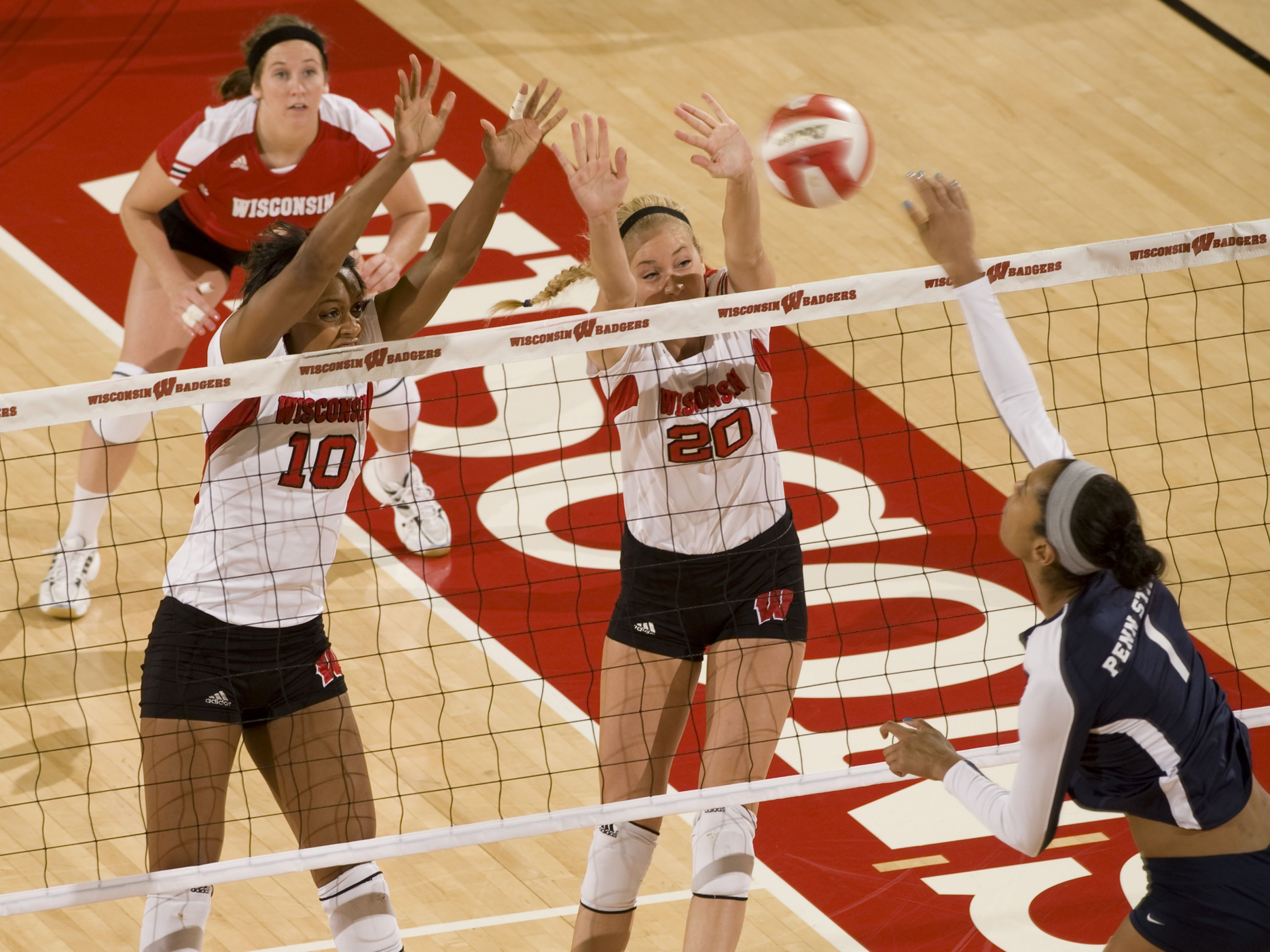 Alexis Mitchell And Ellen Chapman Go Up For A Block Badger Volleyball Favorite Team Volleyball