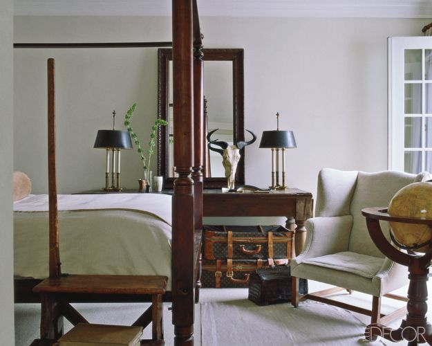 Benjamin Moore's Moonlight White, a very warm white, with Benjamin Moore's Simply White in a satin finish for trim.