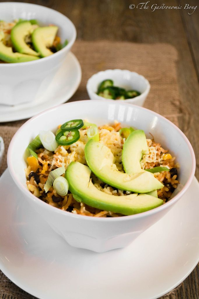 Slow Cooker Chipotle Chicken Burrito Bowl topped with Avocado slices | The Gastronomic BONG