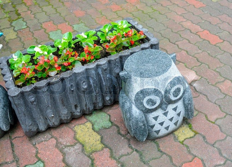 Rock owl statue with flower | Stock Photo | Colourbox on Colourbox