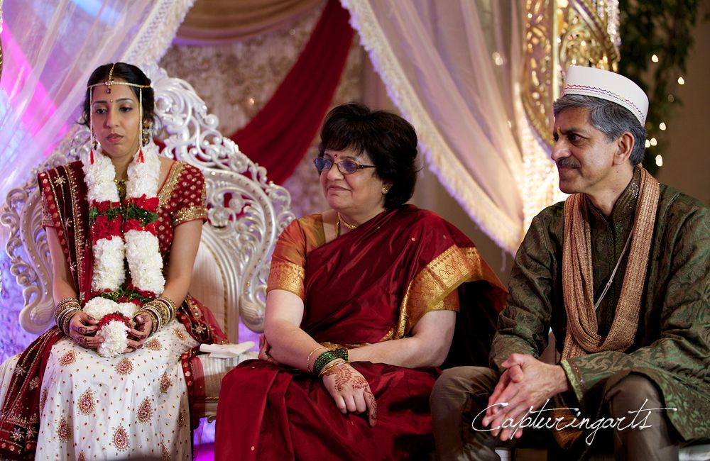 A Bride sits aside her mother and father during the ceremony!