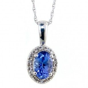 Beautiful tanzanite pendant surrounded in small diamonds set in beautiful tanzanite pendant surrounded in small diamonds set in 10kt white gold aloadofball Gallery