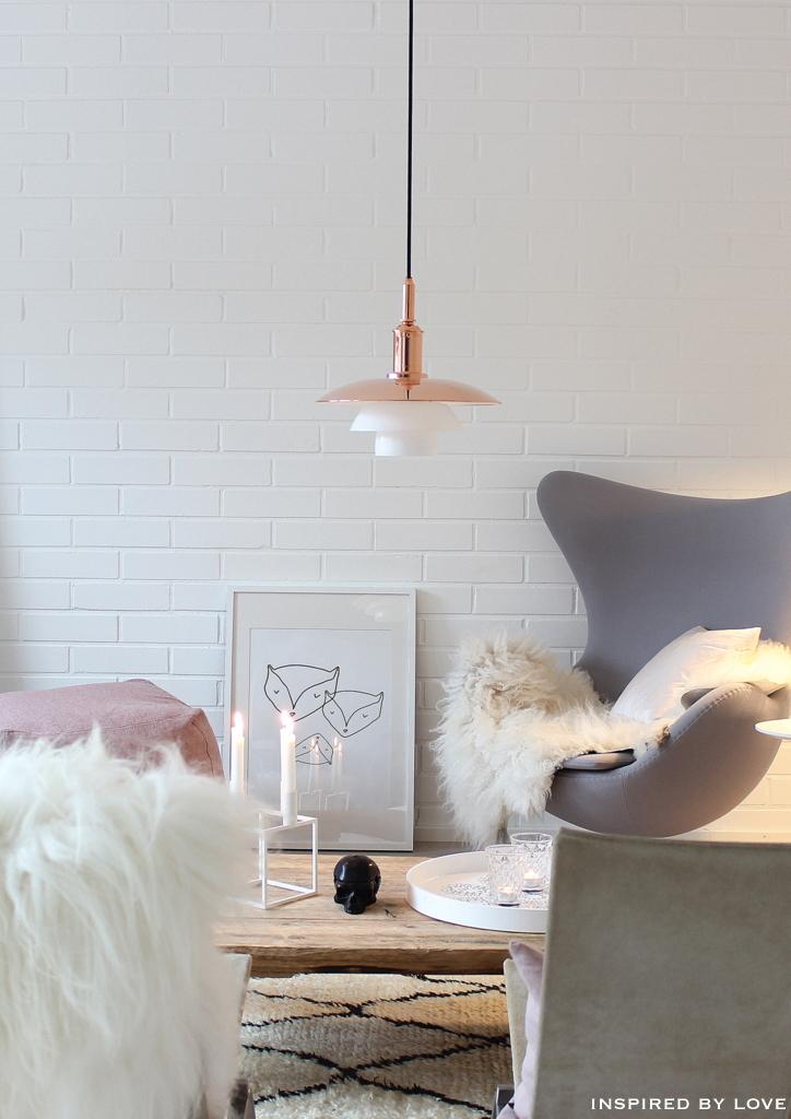 The Scandinavian Design Secret To Make Your Home Feel Bigger Grey Chair Living Room Pastel Interior Living Room Inspiration