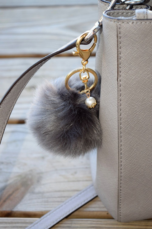 Faux Rabbit Fur Ball Keychain, Handbag, Keyring by ZEnella on Etsy https://www.etsy.com/listing/275090020/faux-rabbit-fur-ball-keychain-handbag