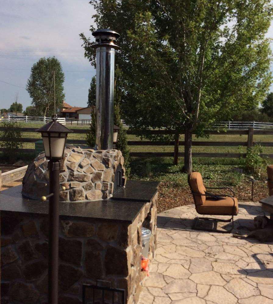 Standaloneoutdoorwoodfiredpizzaoven outdoor kitchen