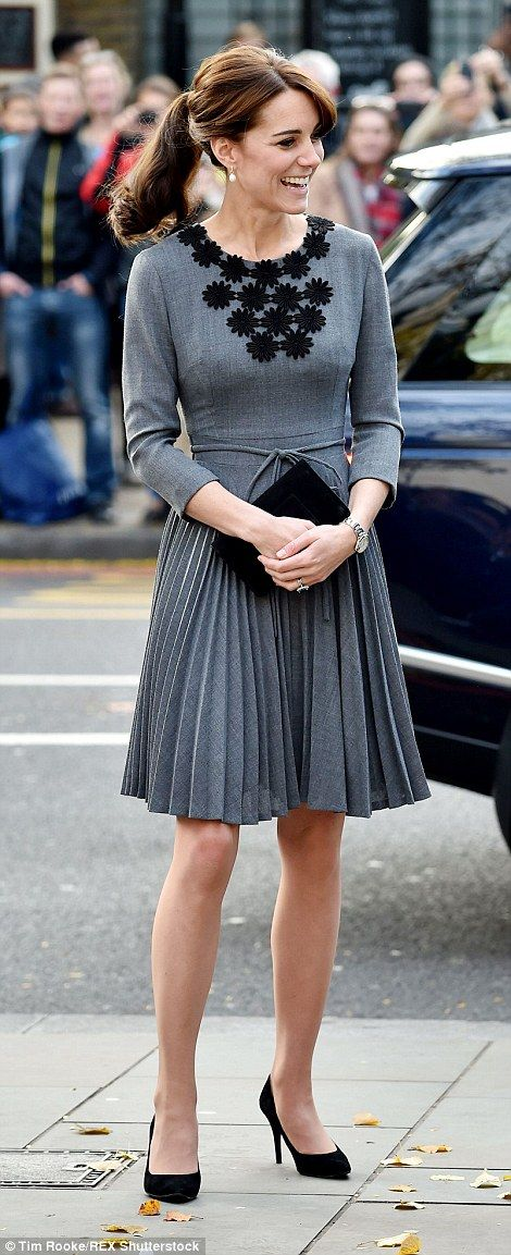 Thrifty Kate chose to recycle a dress from 2012, and the fitted design with pleated skirt highlighted her slender frame