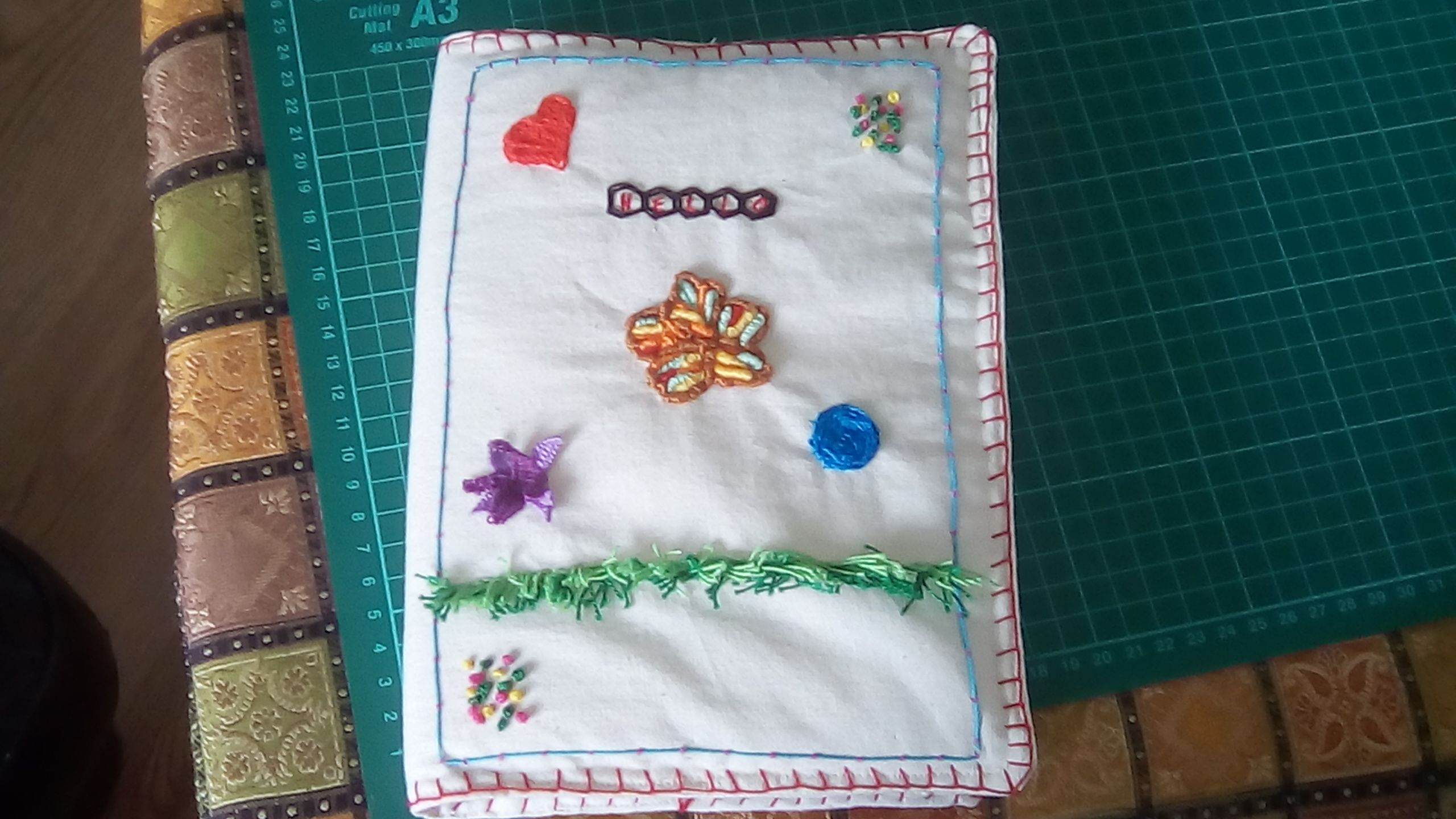 Bookcover with techniques from raised embroiderysearchpress ts