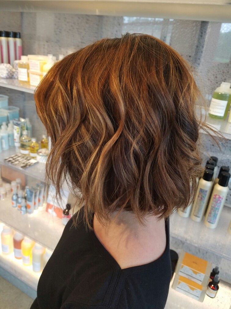 Long bob with curls and balayage highlights