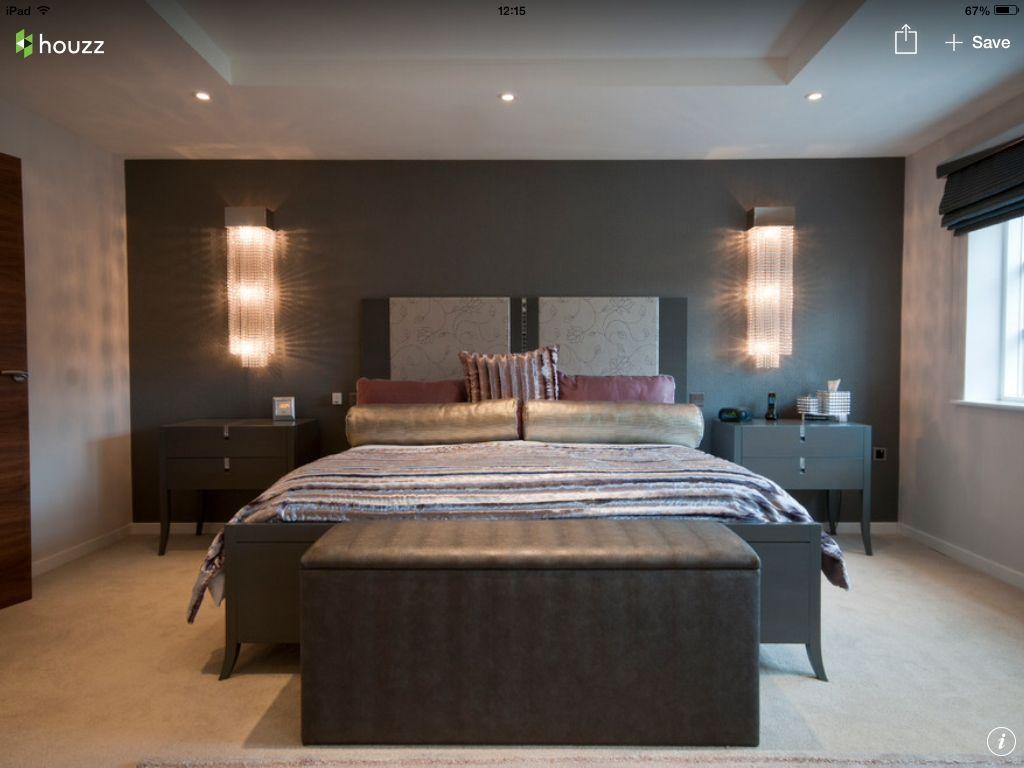 Bedroom with beautiful bedside lights fur throw and metallic