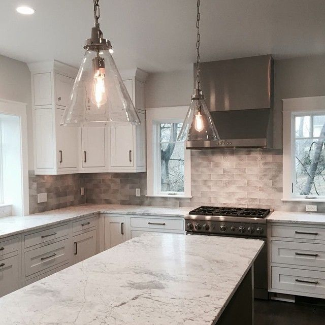 Rain Glass Silver The Tile Featured In This Beautiful Kitchen Backsplash Has A Very Textured Glass Backsplash Kitchen White Kitchen Countertops The Tile Shop