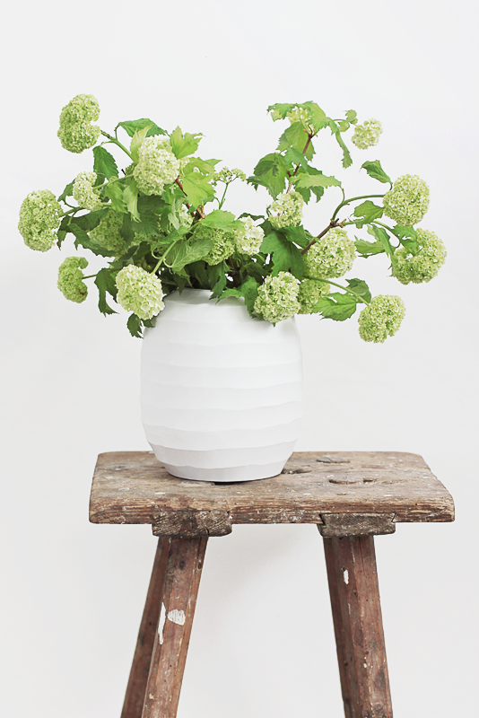 white vase with green