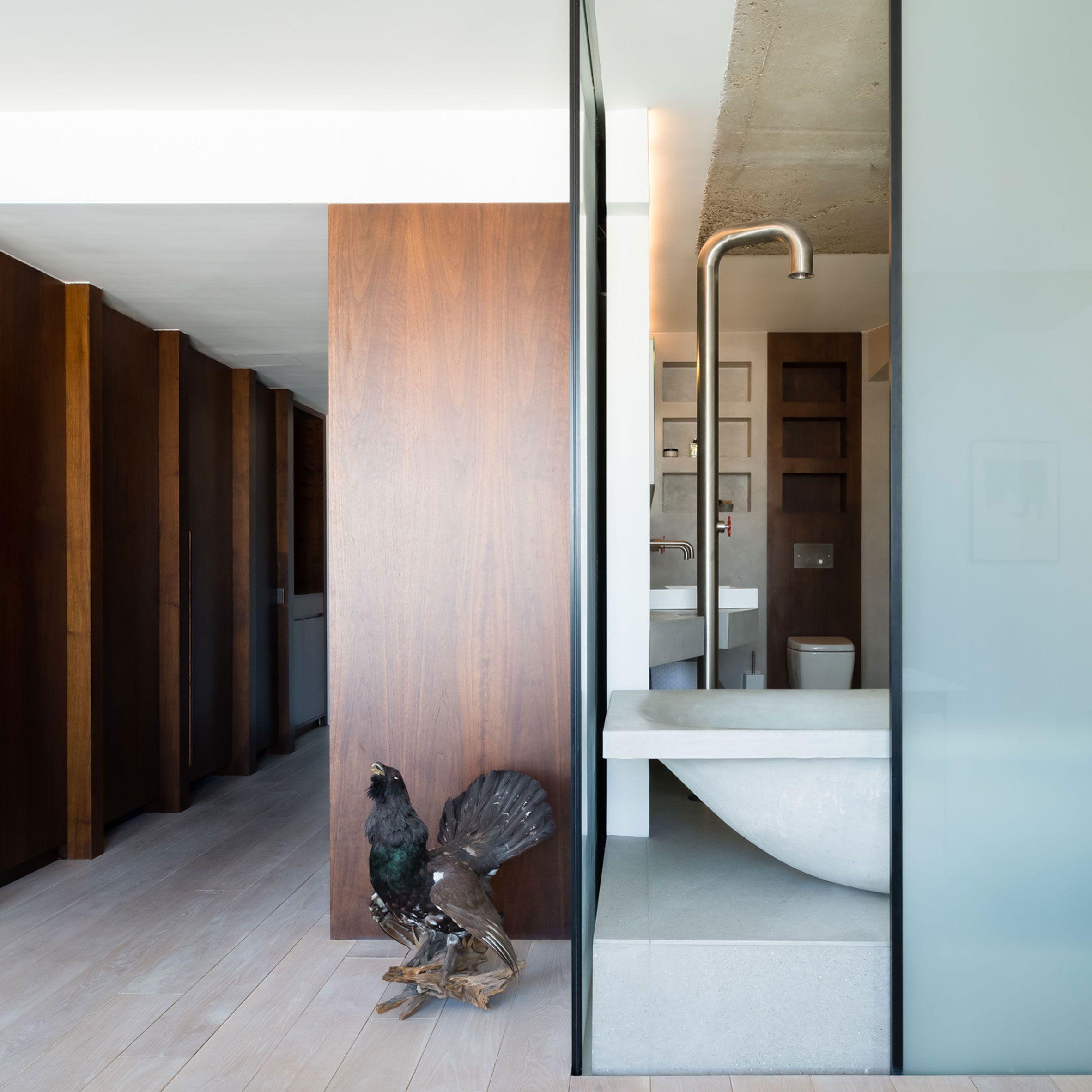 london flat by the klassnik corporation centres around a concrete bath - Concrete Apartment 2016