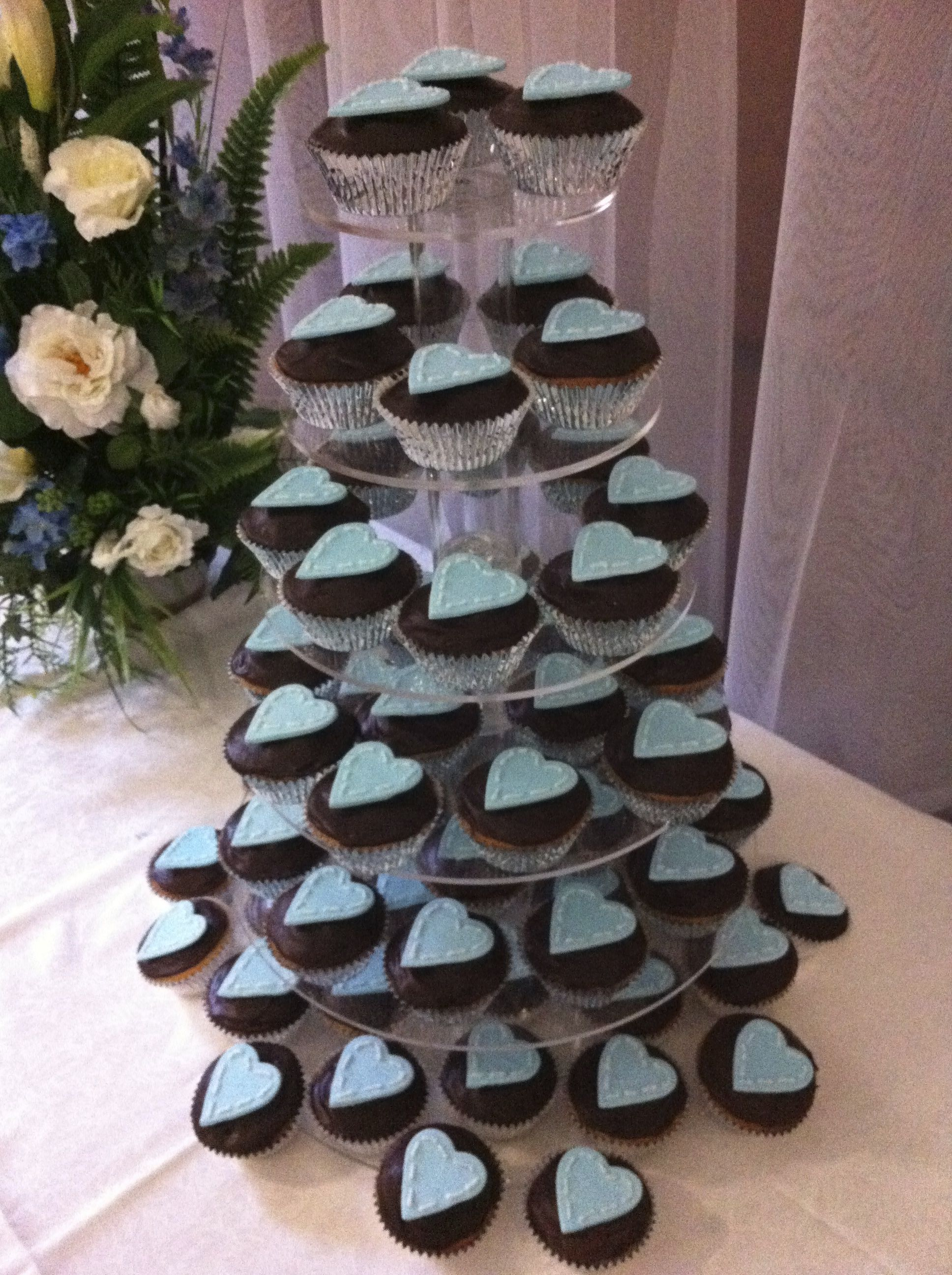 Wedding cupcakes Chocolate cupcakes with dark chocolate ganache Blue hearts with piped royal icing to create stitched edge look