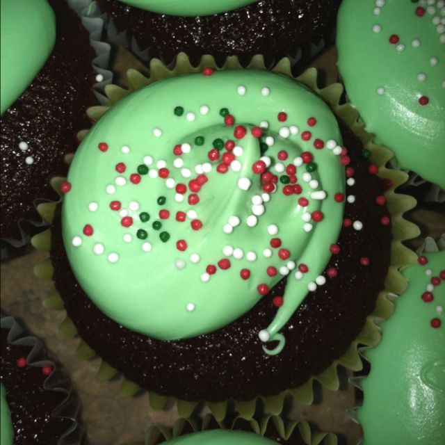 Red velvet cupcakes with green frosting!