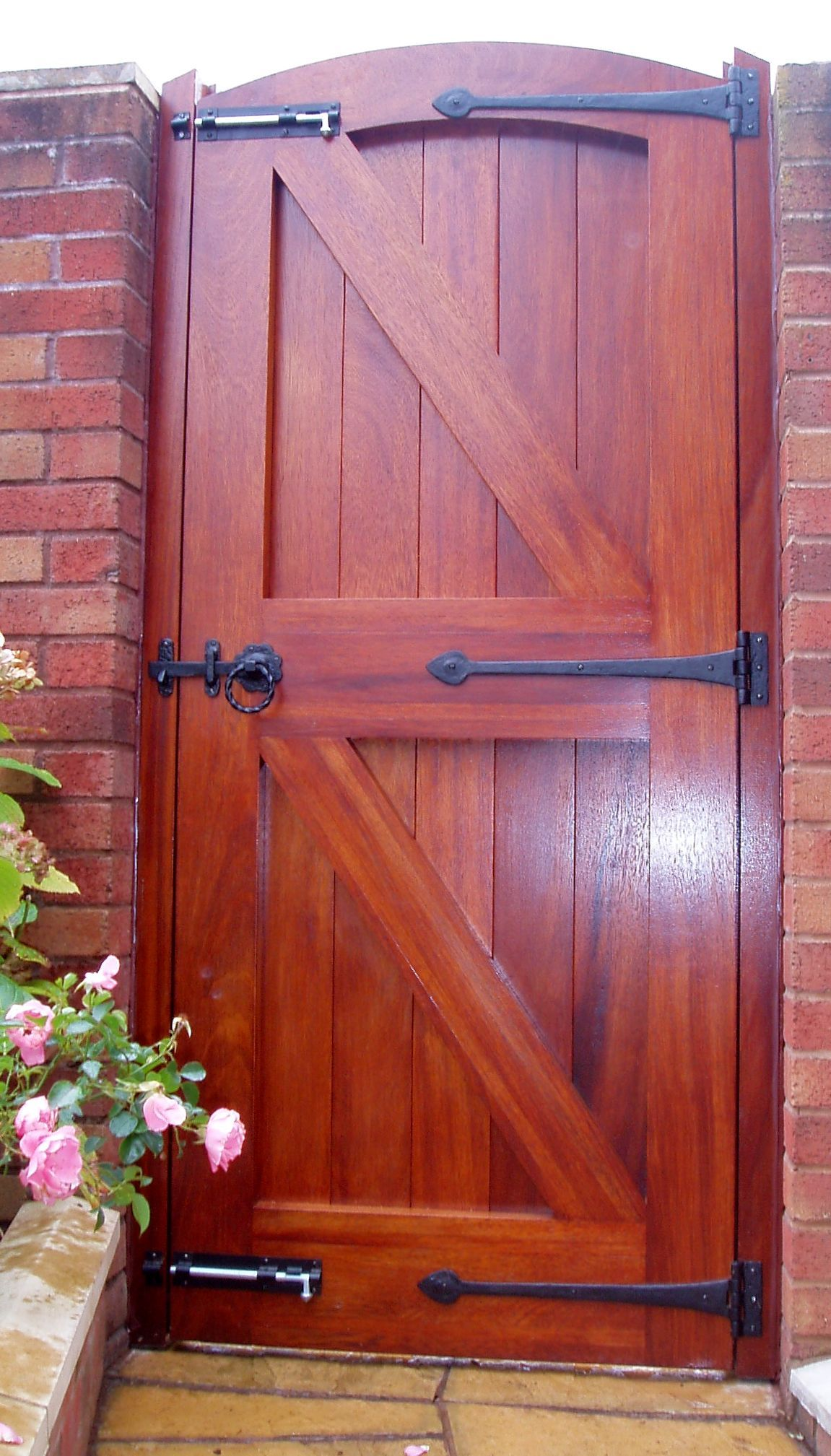 We can advise clients every step of the way from selecting which wood to use to the final coat of paint or stain, as we did for this Idigbo wooden gate. Find out more about our garden gates and doors here http://www.traditional-windows.co.uk/page/oak-buildings/24/