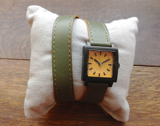This double wrap watch sets itself apart with its small, square face anchored to the narrow, brightly colored all leather band. The Hope's unique overlapping band in combination with the bold color palette create an in demand look perfect for spring or summer. This watch features an Olive Green Band and Orangish-yellow face.