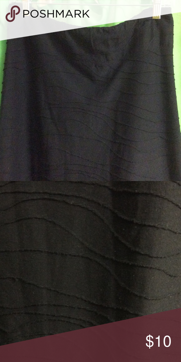 Black Knee length Skirt Knee length black skirt. Has funky pattern on it. Very comfortable. Big waistband. Polyester and rayon. GNW Skirts Midi