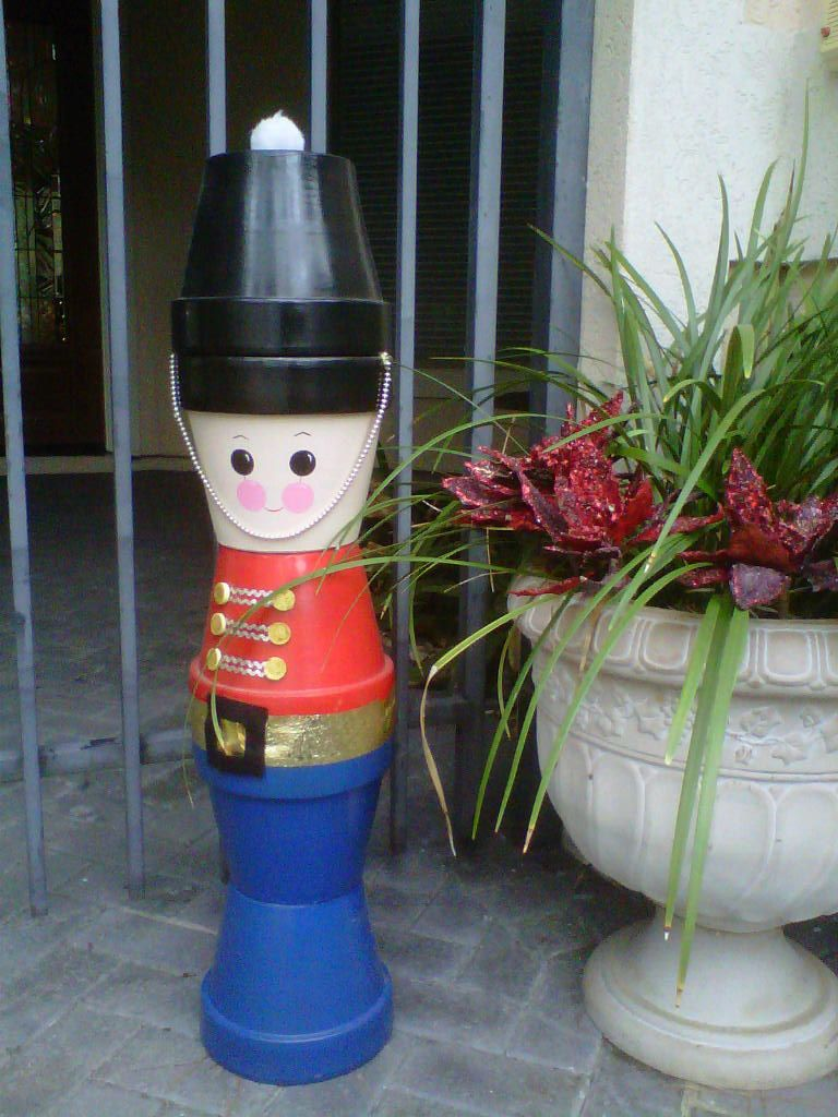Handcrafted toy soldier made from clay flower pots novel