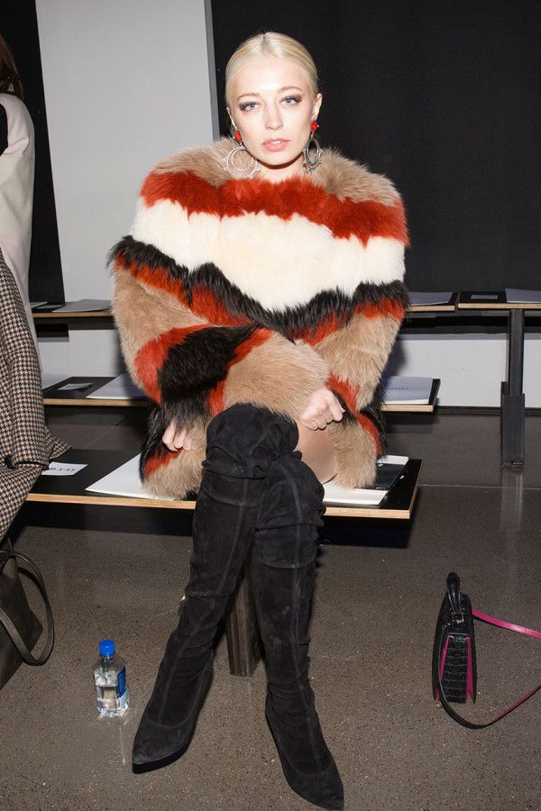Caroline Vreeland wears a faux fur striped coat and over the knee suede boots
