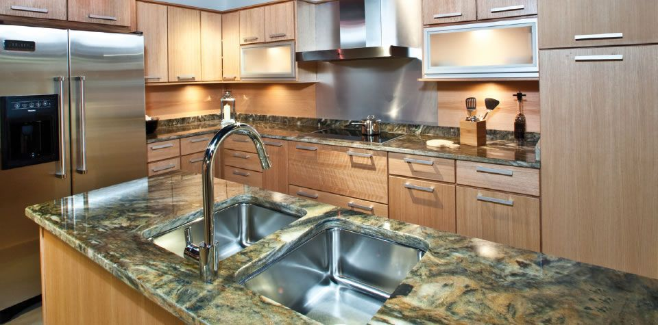 Light maple wood. Sleek design. My kind of kitchen ...