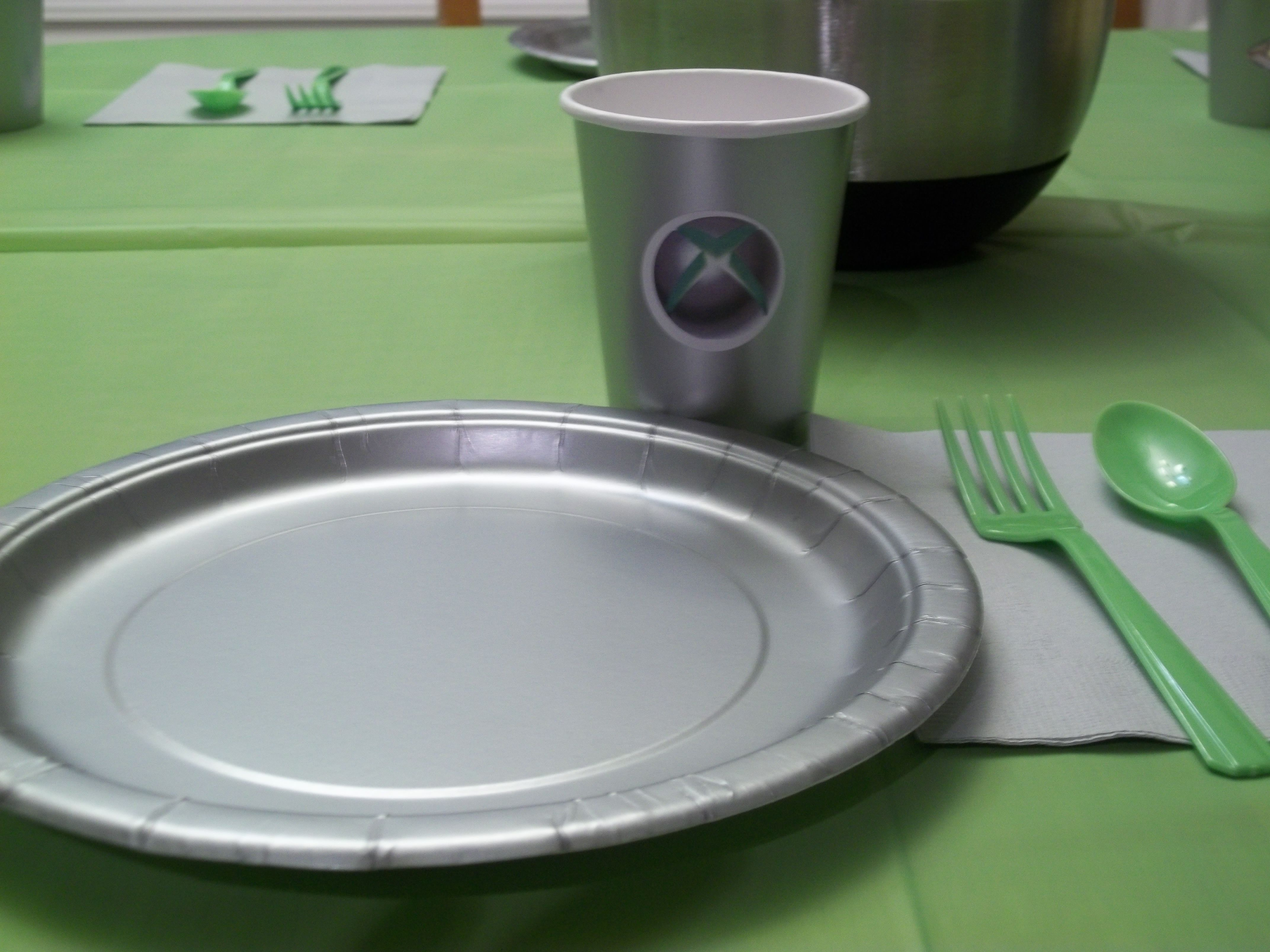 silver cups from the dollar store print xbox logo on round shipping label apply to cup team with silver plates and napkins neon green forks and neon
