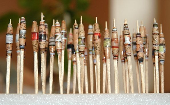 love paper beads. The best are made from recycled magazine pages.