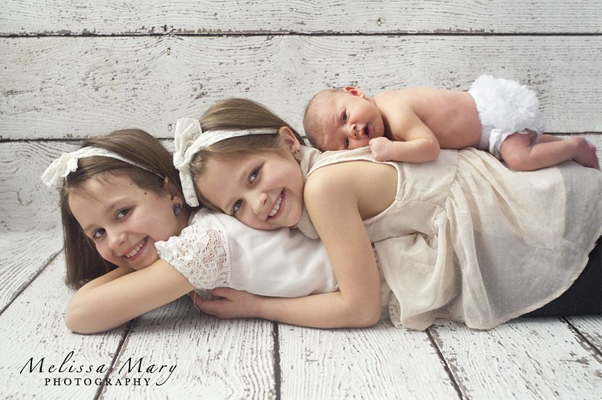 older sibling and baby photo ideas - newborn photography poses photo with sisters sister