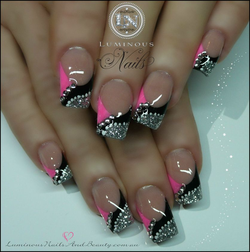 This manicure features the acrylic powder applied on a black and ...
