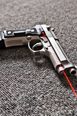 Beretta 92 with Crimson Trace Grips  Need to get me one